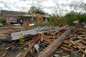Michah Silvernail, age 11, takes photos for his friend Nathan Felton, age 6 (wearing orange), who was huddled with family members in a bathroom while the tornado passed overhead.
