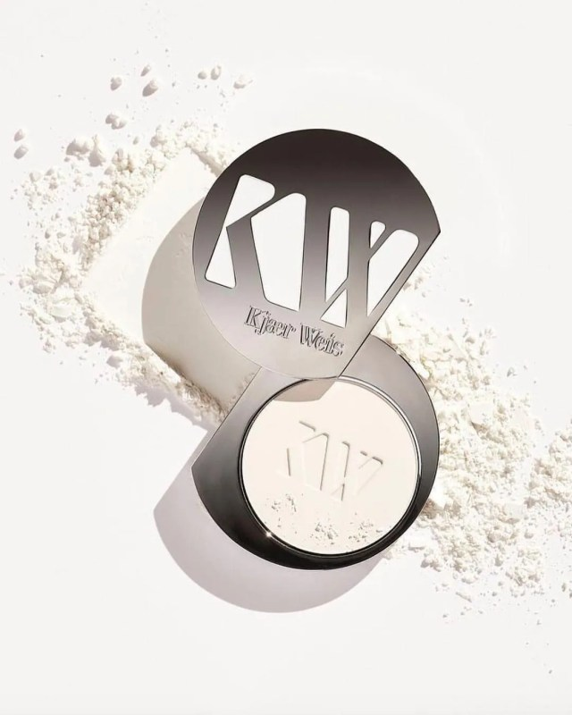 white powder makeup compact metal component opened