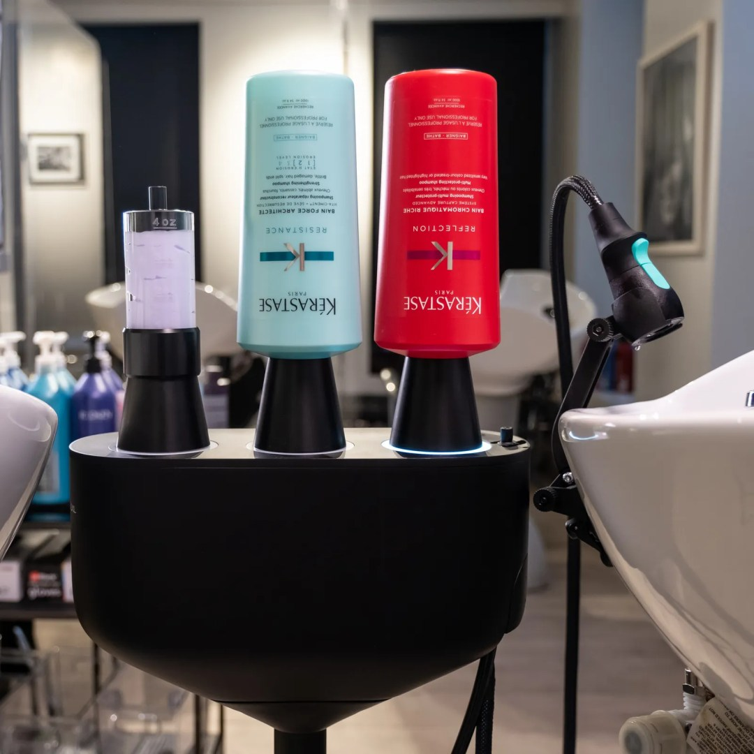 Kerastase products in a salon next to the L'Oreal Water Saver