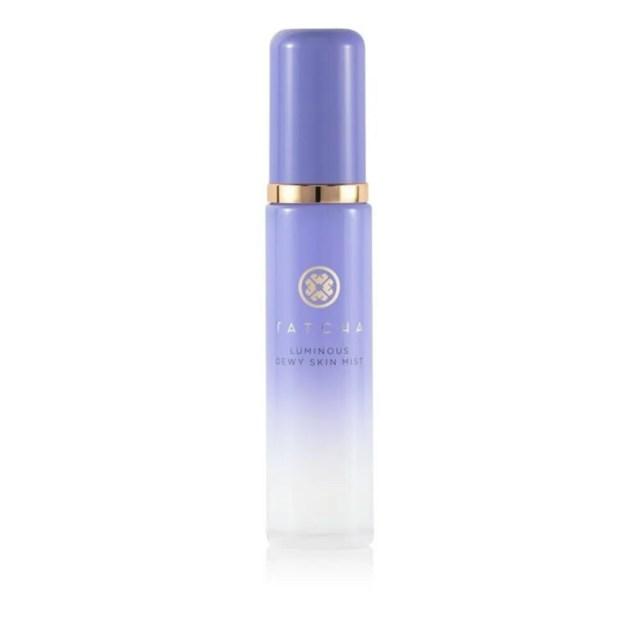 Tatcha Luminous Dewy Skin Mist in lavender plastic bottle on white background
