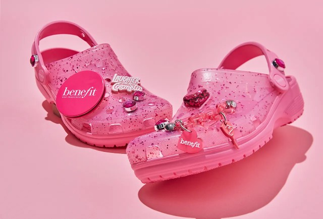 Pink Benefit Crocs on a pink background