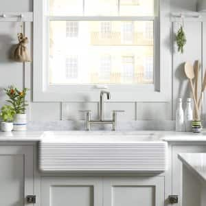 deep kitchen sink brushed bronze faucet shallow vs sinks angie s list farmhouse