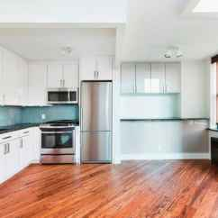 Kitchen Laminate Hotels In Miami With What Is The Best Flooring For A Angie S List White Cabinets Stainless Steel Appliances