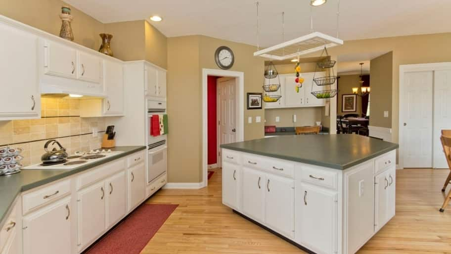 can i paint my kitchen cabinets sink cabinet should or refinish angie s list refacing vs painting