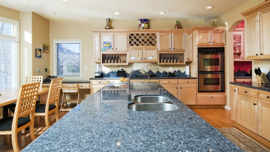 granite kitchen countertops pictures cost of renovation angie s list seamless countertop