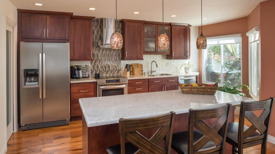 remodeled kitchen glass door cabinet buying supplies cuts remodel costs angie s list newly with tile backsplash and new countertops