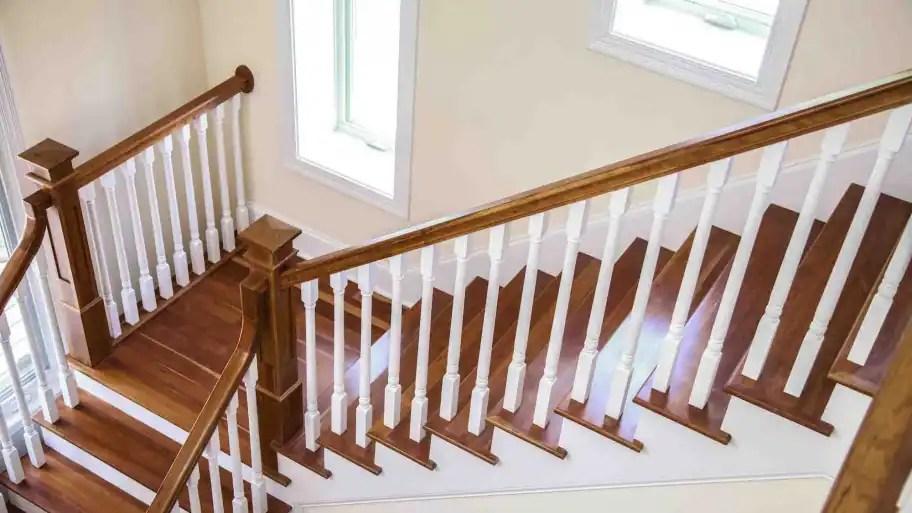 How To Refinish Indoor Stair Railings Angie S List | Refinishing Hardwood Stairs Cost | Basement Stairs | Laminate Flooring | Stain | Hardwood Floor Refinishing | Sanding