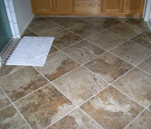 kitchen tile floors cabinet updates how much does it cost to buy and install ceramic angie s list new 16 inch tiles were the order of day in this home two bathrooms dining room hallway plus parts living master