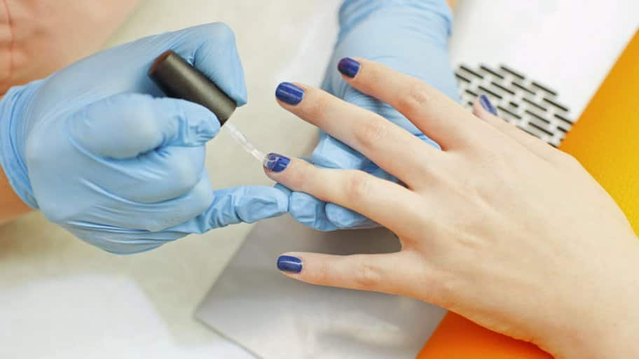 Sac Gel Nail Polish Being Applied To Woman S Hands