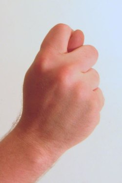 Gesture_fist_with_thumb_through_fingers