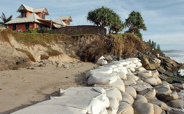 NO FUNDING: Erosion eating away the land at Belongil Beach.