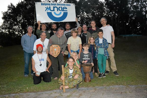 THE MEN FROM UNCLE: Gathered to celebrate the Uncle of the Year, Shaun Macgillivray holding the sheild.