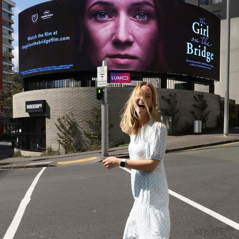 Jazz with a billboard of her documentary. Picture: Supplied.