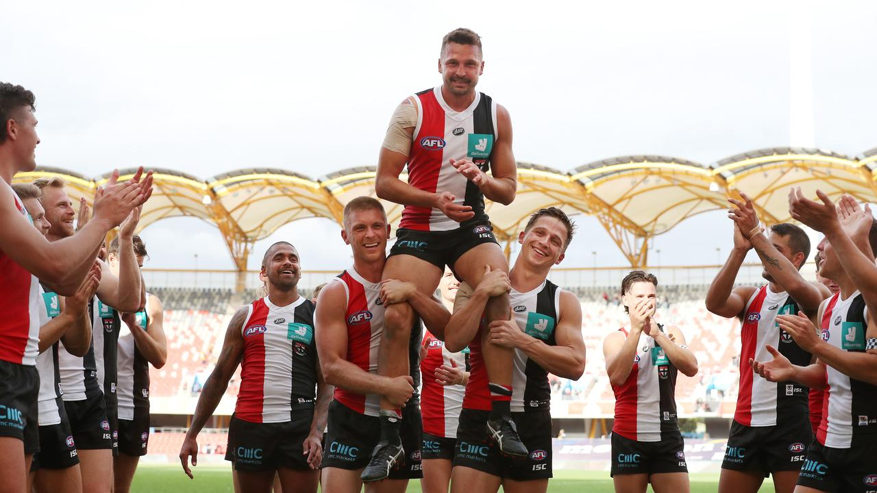 Jarryn Geary of the Saints gets chaired off the ground after game 200. Picture: Michael Klein.