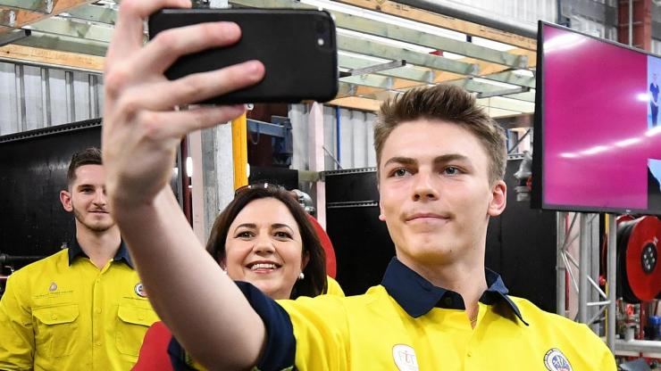 Apprentice Sage Maxwell takes a selfie with Queensland Premier Annastacia Palaszczuk. Picture: NCA NewsWire / Dan Peled