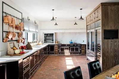 pot racks for kitchen cost per linear foot cabinets the ultimate in chic organization architectural martyn lawrence bullard transformed california home of ellen pompeo creating actress s dream rack was made from an original design