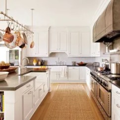 Pot Racks For Kitchen Ice Maker The Ultimate In Chic Organization Architectural At A Southampton New York Home Decorated By Husband And Wife Design Team Carrier Co Custom Ann Morris Rack Light Fixture Hangs