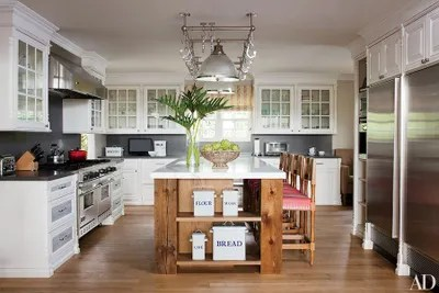 pot racks for kitchen chandelier over island the ultimate in chic organization architectural a bel air california conceived by designer trip haenisch features barstools hollywood at home and rack ann morris antiques