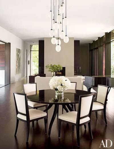 in a polished new canaan connecticut dining room a bourgeois bohme light fixture dangles above the
