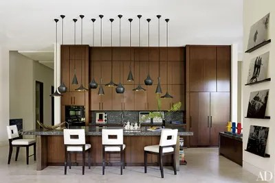 lighting for kitchen wall tiles 31 kitchens with pretty pendant architectural digest tom dixon lights accent this which is outfitted walnut cabinetry by furze bard