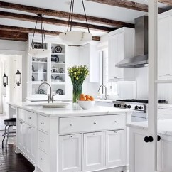Kitchen Pendant Lights Italian Themed Curtains 31 Kitchens With Pretty Lighting Architectural Digest Oak Beams Shelter This Which Has A Viking Hood And Cooktop Calacatta Gold Marble Counters The Alabaster Are By Urban