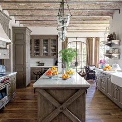 Kitchen Pendant Lights Faucet Installation Cost 31 Kitchens With Pretty Lighting Architectural Digest Antique Tunisian Tile From Exquisite Surfaces Creates A Lively Backsplash In This Which Is Appointed Formations