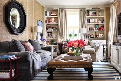 ottoman tables living room furniture chicago how to incorporate ottomans into your decor in the library of ali wentworth and george stephanopoulos s manhattan apartment decorated by michael smith mirror are english