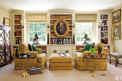 chairs with ottomans for living room ikea rocking chair how to incorporate into your decor the 18th century portrait in reading area of timothy corrigan s los angeles home is a family ancestor monte allen armchairs and ottoman are clad