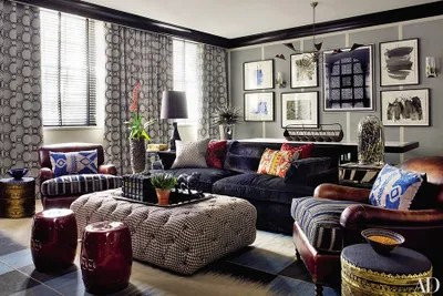 chairs with ottomans for living room posture corrector work chair how to incorporate into your decor zandberg designed the den s sofa upholstered in a de le cuona fabric and button tufted ottoman