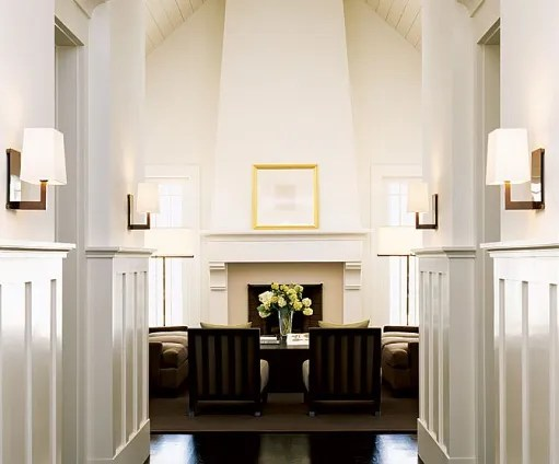 """""""It's wine country Craftsman meets New England cottage, pared down by a minimalist execution,"""" designer Michael Vanderbyl says of the house he and his wife, textile designer Anna Hernandez, built in St. Helena, California. Above: The entrance hall leads to a large living room with a 19-foot-high cathedral ceiling. """"Wainscoting anchors the space,"""" says Vanderbyl. (September 2005)"""