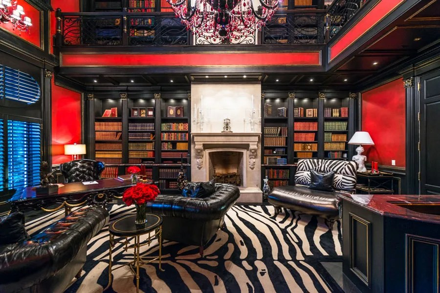 There's also a library with a spiral staircase that leads to both the wine cellar and a parlor with leather walls and a fireplace.