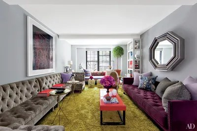 gray living room furniture ideas modern photos inspiring architectural digest the walls of stylist carlos mota s new york city home are painted in a donald kaufman bespoke button tufted sectional and low back sofa