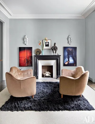 living room mantel decor furniture for small singapore fireplace inspiration architectural digest in the master bedroom of fashion designer stefano pilati s paris duplex colorful photographs by jeff burton flank granite which is topped with