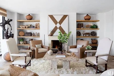 fireplace for living room decorate a small apartment ideas and designs architectural digest mark hagen painting hangs above the in of movie producer avi
