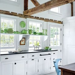 White Kitchen Cabinets Faucet Repair Kit Ideas And Inspiration Architectural Digest Dodie Thayer Lettuceware Contrasts Beautifully With The Shelving Cabinetry In Upstate New York Of Lighting Designer Christopher