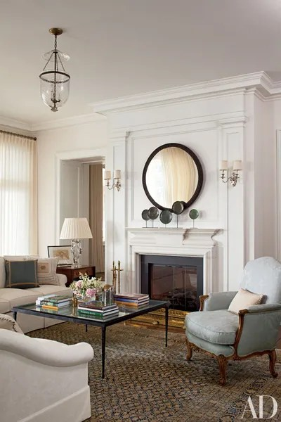 living room mantel decor wall pictures for cheap fireplace inspiration architectural digest silverplate sconces from remains lighting flank the in a long island new york
