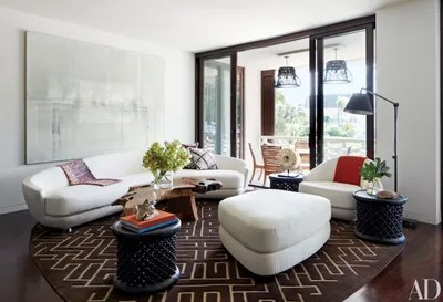 living room ottoman ideas rooms curtains how to incorporate ottomans into your decor an auguste garufi mixed media work dominates one wall of the dining area in a florida home by tsao mckown architects calvin designed sofa