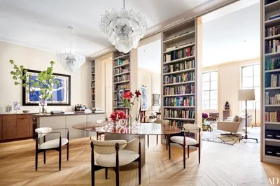 new living room design blue modern 18 stylish homes with interior architectural digest in the york city loft of architect steven harris and designer lucien rees roberts monumental bookshelves delineate dining areas