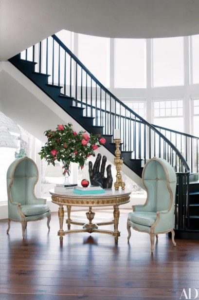 The foyer features a pair of custom-made chairs covered