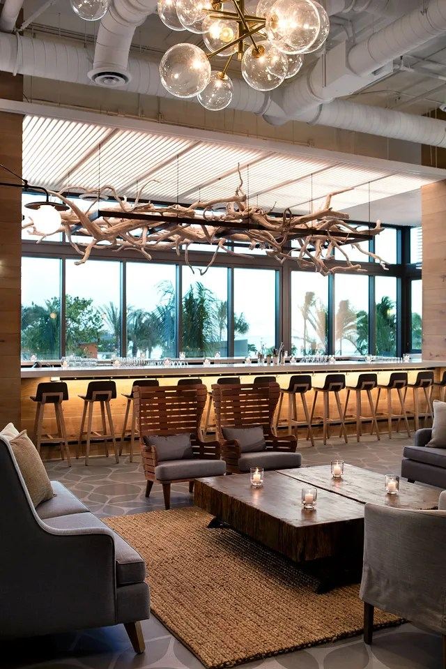 wooden restaurant chairs patio chair leg caps lowes tour the new seafire resort + spa on grand cayman photos | architectural digest