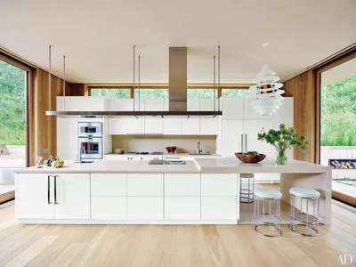 white kitchen cabinets cabinet repainting ideas and inspiration architectural digest in the of an aspen home designed by shawn henderson a vintage louis poulsen pendant
