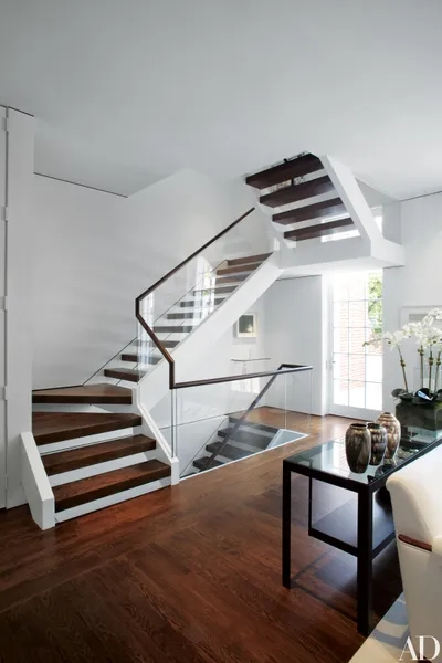 15 Striking Modern Staircases Architectural Digest | Living Room Railing Design | Balcony | Stair Case | Flooring | Step Down | Wrought Iron