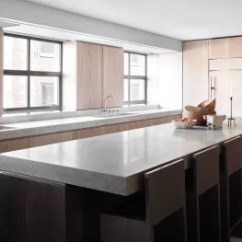 Kitchen Island Counter Ninja Mega System Reviews 28 Stunning Ideas Architectural Digest Single Slabs Of Carrara Marble And Basaltina Top The In A Manhattan