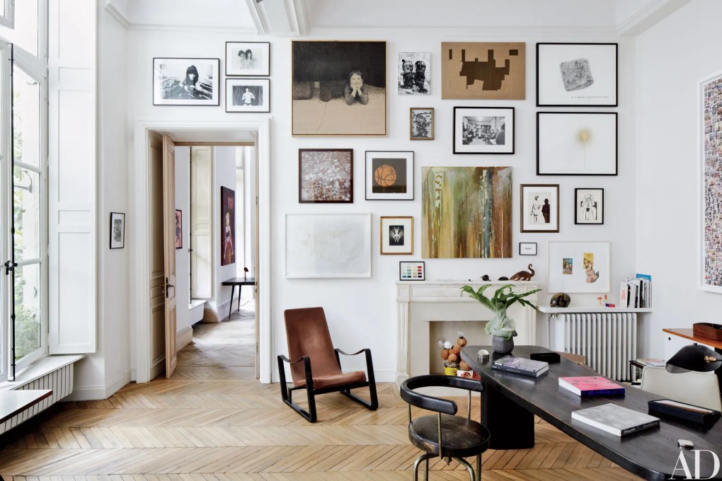 Patrick's study features a wall of artworks by Richard Kern David Noonan Sam Durant Carol Bove and others