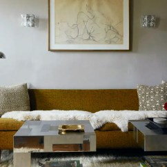 Home Decor Ideas Living Room Apartment Design White Walls Diy Are Literally Everywhere In This Brooklyn An Abstract Drawing Is Flanked By Twin Sconces Above Olivegreen Couch And Metallic Cubist Coffee