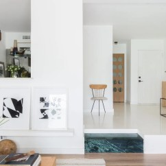 Flooring Living Room Kitchen Mini Bar Furniture For Is Epoxy The New Polished Concrete Architectural Digest An Open And Featuring A Distinctive Green Marble Step Between Them