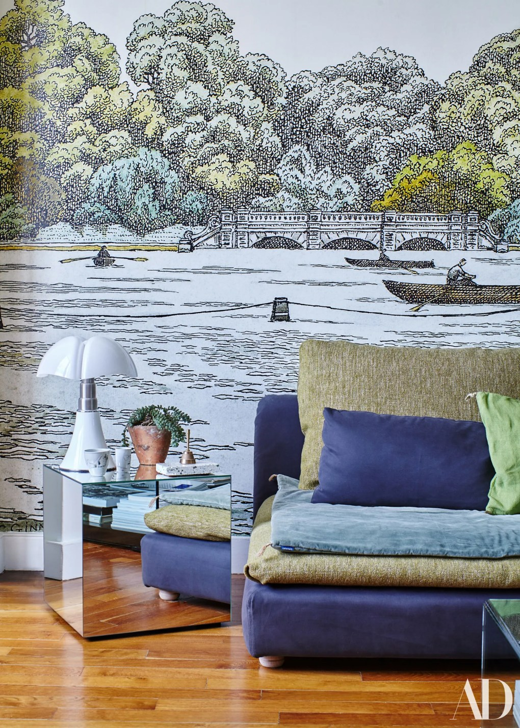Landscape wall mural and mirror table in Paris apartment.