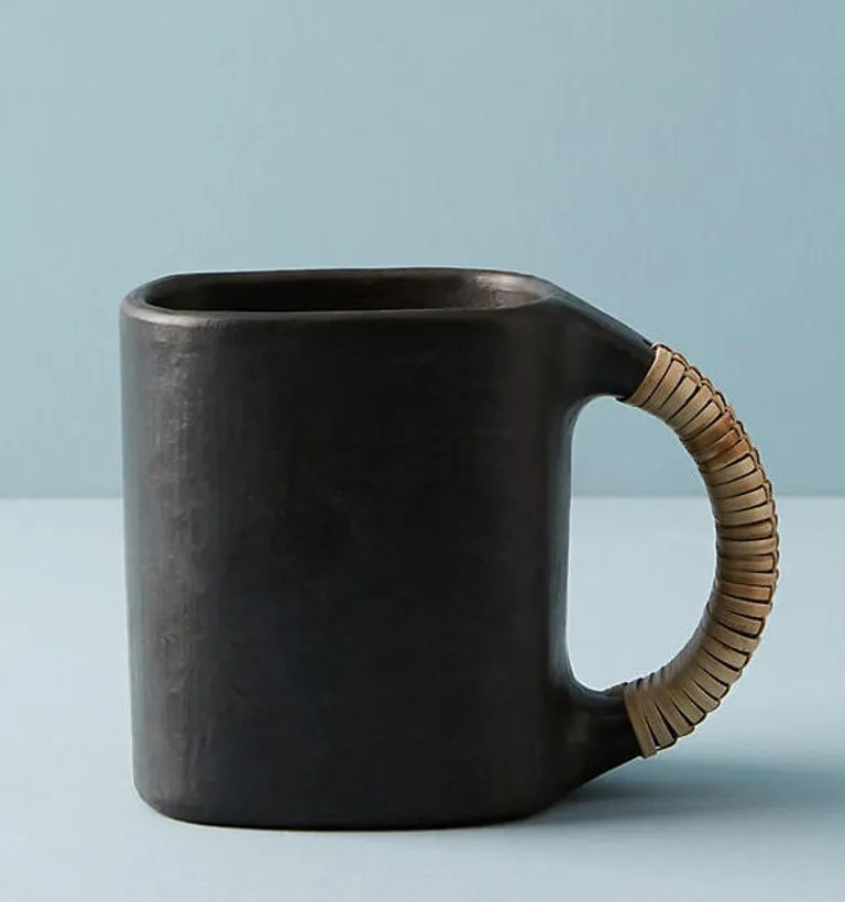 Crafted from ebony-toned serpentine rock, this mug would be striking even without the wicker handle. SHOP NOW: Serpentinite Mug, $16, anthropologie.com