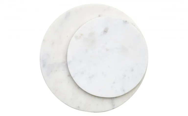 """A simple, perfect circle of marble can be so many things: a cheese board, a bar gear holder, a place to set your pot right on the table. SHOP NOW: 8"""" Round Marble Board by Jayson Home, $25, jaysonhome.com"""