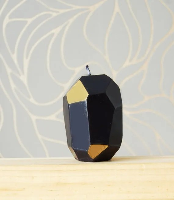 Faceted black-and-gold candle